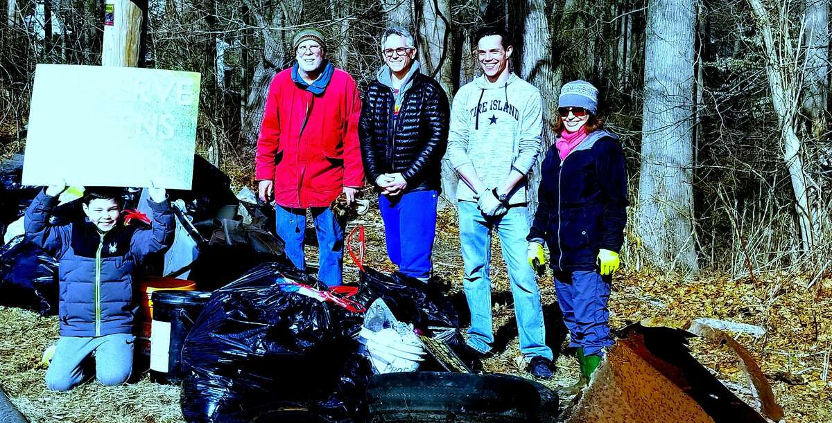 Westport residents gather at the Sherwood Island Connector Park and Ride on Feb. 16 to clean up the littered property.