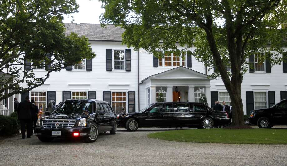 Limousines and motorcade vehicles for President Barack Obama are seen parked in the driveway outside the residence of movie producer Harvey Weinstein in 2012. Photo: Pablo Martinez Monsivais / Associated Press / Associated Press