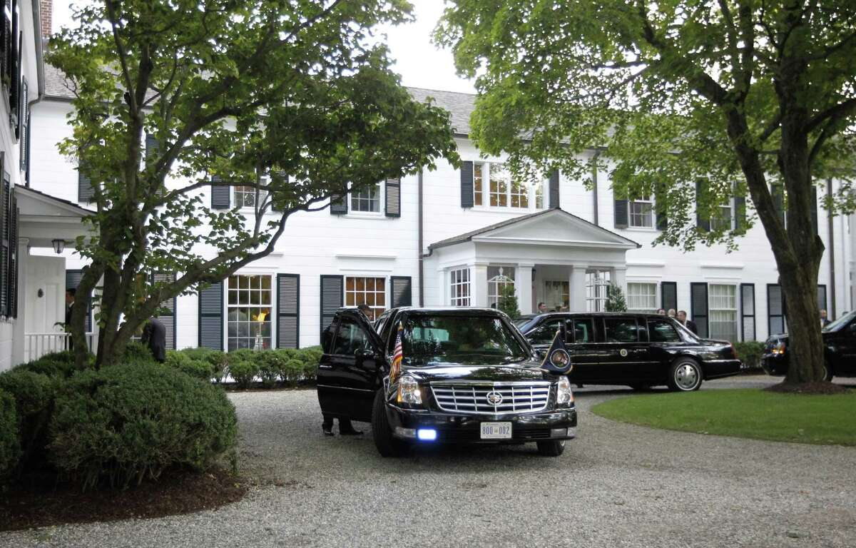 Limousines and motorcade vehicles for President Barack Obama are seen parked in the driveway outside the residence of movie producer Harvey Weinstein in 2012.