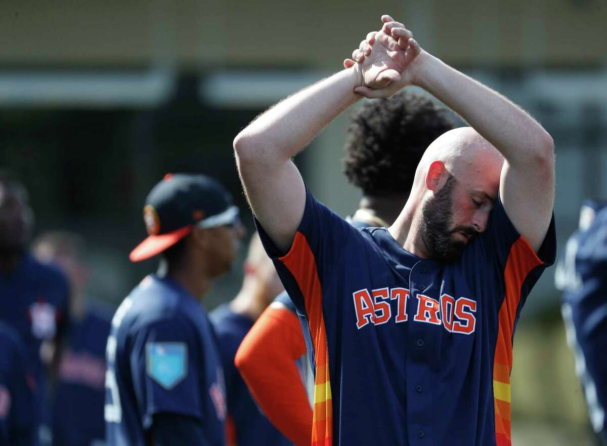 Houston Astros RHP pitcher Mike Hauschild (68) wipes sweat during spring training at The Fitteam Ballpark of the Palm Beaches, Thursday, Feb. 22, 2018, in West Palm Beach.