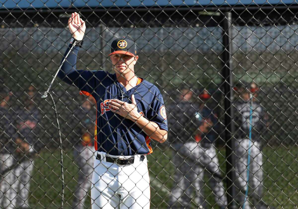Houston Astros RHP pitcher Jacob Dorris (82) warms up his arm before workouts during spring training at The Fitteam Ballpark of the Palm Beaches, Thursday, Feb. 22, 2018, in West Palm Beach.