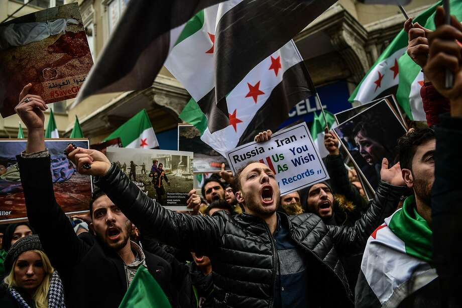Demonstrators protest air strikes in Syria in front of the Russian Consulate in Istanbul, Turkey. Photo: OZAN KOSE, AFP/Getty Images