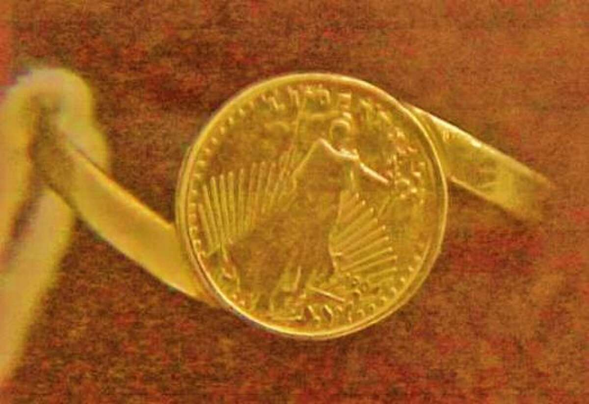 The victim was found wearing this 1904 gold St. Gauden's coin made into a ring, which was sold in tenn magazines in the 70s and 80s.