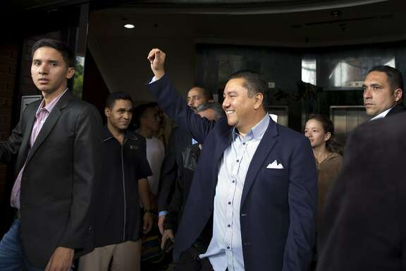 Venezuelan presidential candidate Javier Bertucci acknowledges supporters, in Caracas, Venezuela, Wednesday, Feb. 21, 2018. With two months to go before Venezuela's make-or-break presidential elections, Bertucci, a television evangelist, is the only candidate who has thrown himself in the ring against President Nicolas Maduro. (AP Photo/Ariana Cubillos)