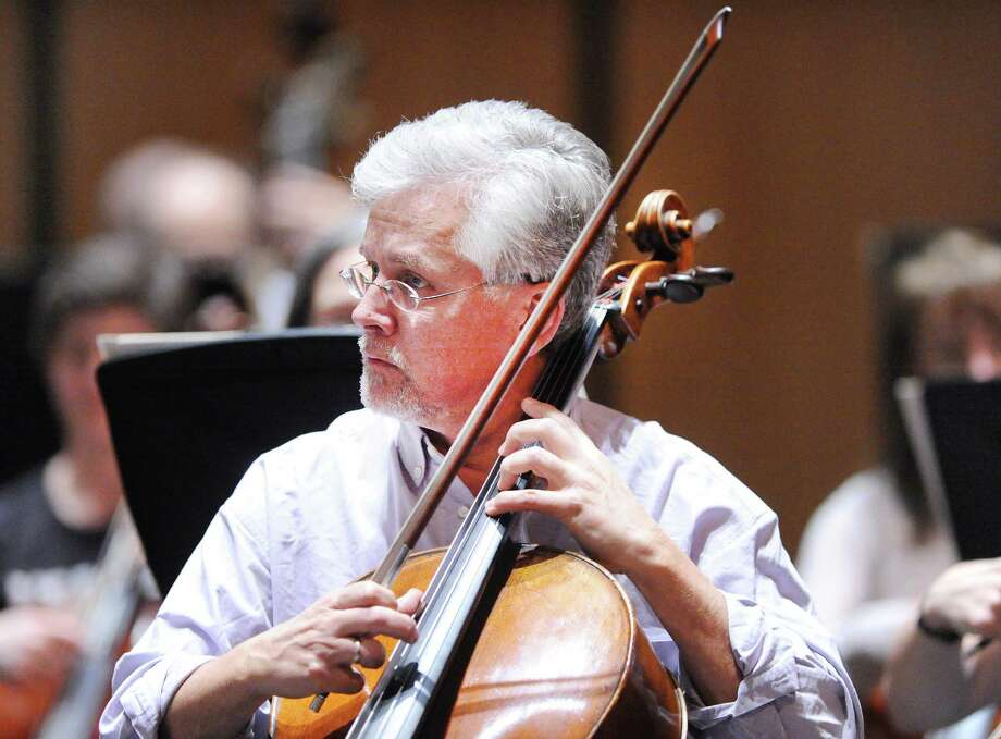 Danny Miller, a cellist with the Greenwich Symphony Orchestra, during rehearsal at the Greenwich High School Performing Arts Center, Greenwich, Conn., Tuesday night, Feb. 20, 2018. The Greenwich Symphony Orchestra will be performing two concerts this weekend at the GHS PAC. The first is scheduled for Saturday night at 8 p.m. with another performance the Following Sunday at 4 p.m. Photo: Bob Luckey Jr. / Hearst Connecticut Media / Greenwich Time