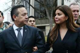 Texas State Sen. Carlos Uresti looks at his wife, Lleanna, as they leave the U.s. Federal Courthouse after his conviction on all 11 counts in his criminal fraud trial, Thursday, Feb. 22, 2018. Uresti and his co-defendant, Gary Cain, were convicted in relations to the failed FourWinds Logistics fracking company. On the right is his attorney, Michael McCrum.