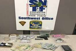 State police said they seized nearly a half pound of heroin, cash and a gun from Aaron Kearney's Huntington Road home on Wednesday.