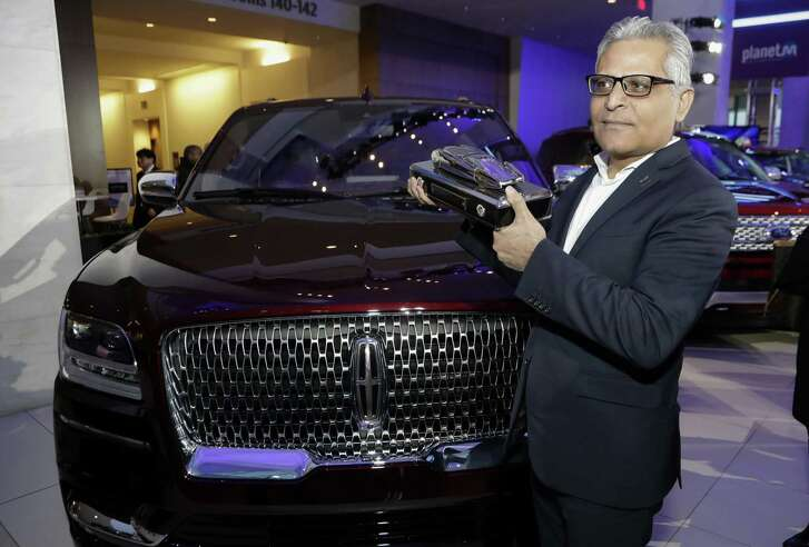 FILE- In this Jan. 15, 2018, file photo, Kumar Galhotra, group vice president for Lincoln stands next to the 2018 Lincoln Navigator after the vehicle won truck of the year during the North American International Auto Show in Detroit. Ford Motor Co. said Thursday, Feb. 22, that it is naming Galhotra as a replacement for Raj Nair, the president for North America who was ousted this week over allegations of inappropriate behavior. Galhotra will take over on March 1.