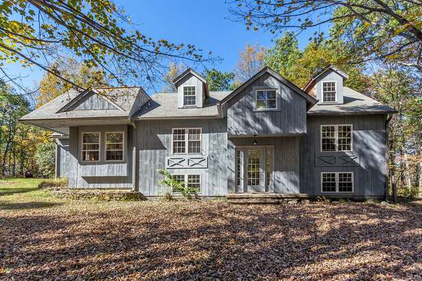 The contemporary barn at 25 Bald Hill Road in Kent fits in with its rustic settings and isn't your typical Connecticut home.