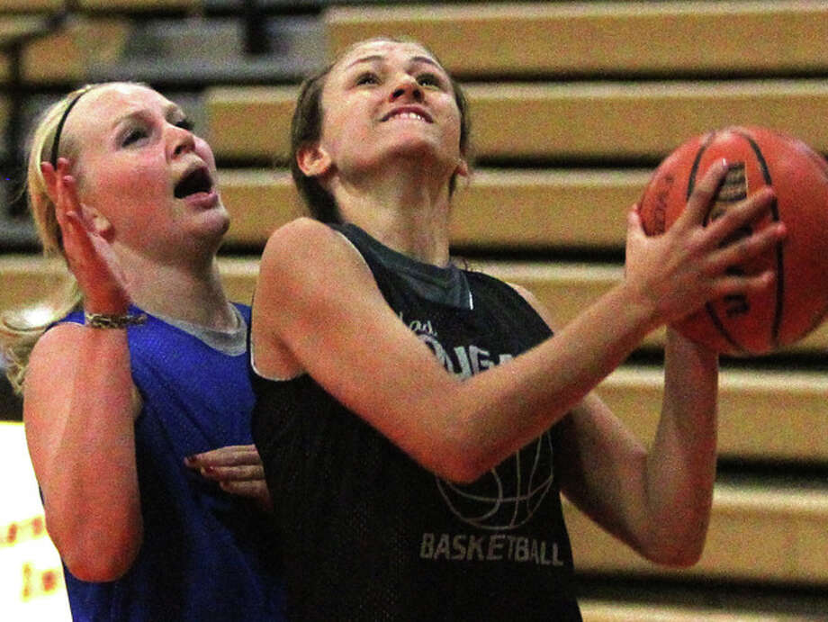 West Central's Annika Kaufmann drives to the basket against Bushnell in the championship game of the Beardstown summer league tournament.
