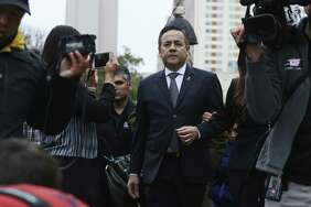 Surrounded by media, state Sen. Carlos Uresti leaves the Federal Courthouse after his conviction on all 11 counts in his criminal fraud trial, Thursday, Feb. 22, 2018. Uresti and his co-defendant, Gary Cain, were convicted in relation to the failed FourWinds Logistics fracking company.