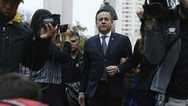 Surrounded by media, Texas State Sen. Carlos Uresti leaves the Federal Courthouse after his conviction on all 11 counts in his criminal fraud trial on Thursday. Uresti and his co-defendant, Gary Cain, were convicted in relation to a Ponzi scheme within the failed FourWinds Logistics fracking-related company.