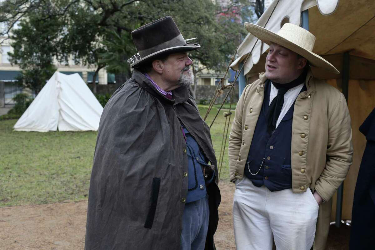 Alamo living historians John Potter, left, chats with Tim Hicks outside their tent at the Alamo, Wednesday, Feb. 21, 2018. The Alamo will have a full 13 days of lectures, re-enactments, demonstrations and ceremonies commemorating the 13-day siege and battle of 1836, starting Friday, including evening tours on the Alamo grounds, a free screening of the 1960 John Wayne movie and a lecture by premier Alamo artist Gary Zaboly.
