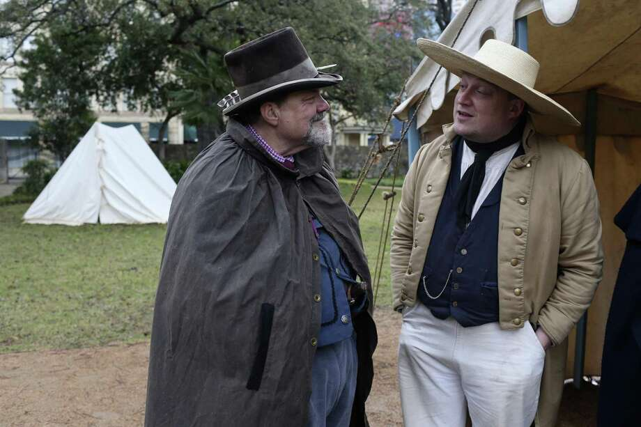 Alamo living historians John Potter, left, chats with Tim Hicks outside their tent at the Alamo, Wednesday, Feb. 21, 2018. The Alamo will have a full 13 days of lectures, re-enactments, demonstrations and ceremonies commemorating the 13-day siege and battle of 1836, starting Friday, including evening tours on the Alamo grounds, a free screening of the 1960 John Wayne movie and a lecture by premier Alamo artist Gary Zaboly. Photo: JERRY LARA, Staff / San Antonio Express-News / © 2018 San Antonio Express-News
