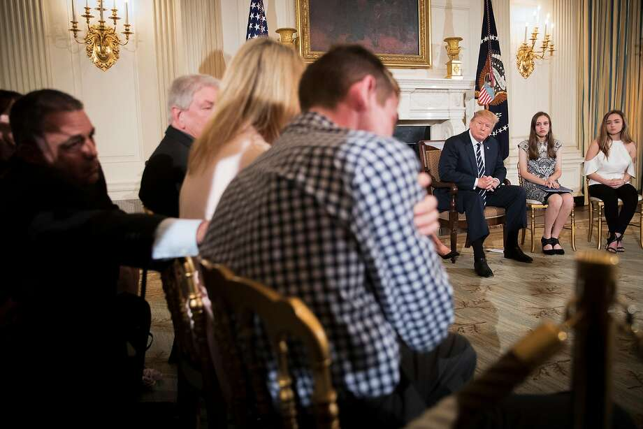 Marjory Stoneman Douglas High School shooting survivor Samuel Zeif, center, speaks to President Trump at the White House on Wednesday. Trump took to Twitter Thursday morning to say that he does not want to give teachers guns to fight deadly mass shootings at schools. He explained that he wants to give concealed guns to teachers with military or special training experience, and restated his policy agenda for school safety ahead of a meeting with state and local officials later in the day. (Tom Brenner/The New York Times) Photo: TOM BRENNER, NYT