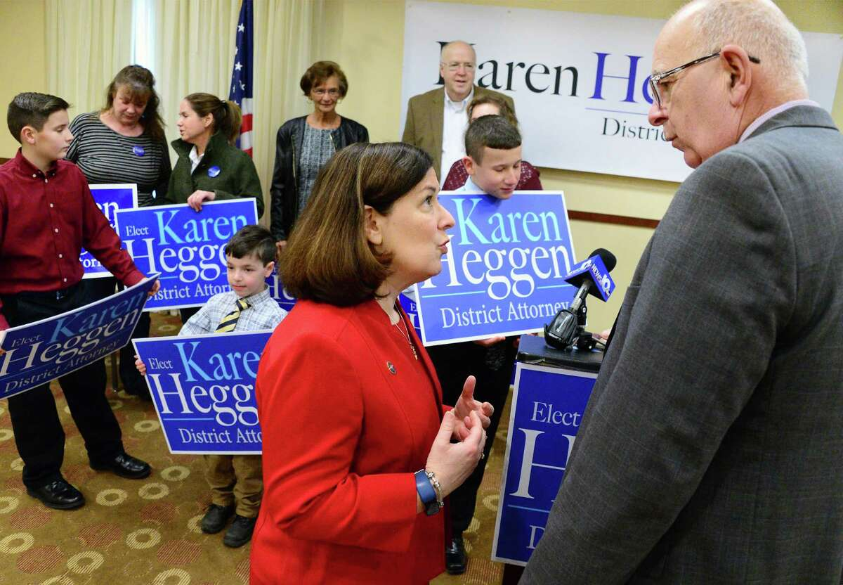 Saratoga County District Attorney Karen Heggen, center, speaks with Sheriff Michael Zurlo during the announcement of her re-election bid Thursday Feb. 22, 2018 in Malta, NY. (John Carl D'Annibale/Times Union)