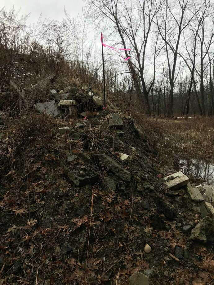 Some of the construction debris that spills into the Pine Bush Preserve from the J.C. McCashion Contracting Co. Photo: Courtesy Of The Department Of Environmental Conservation
