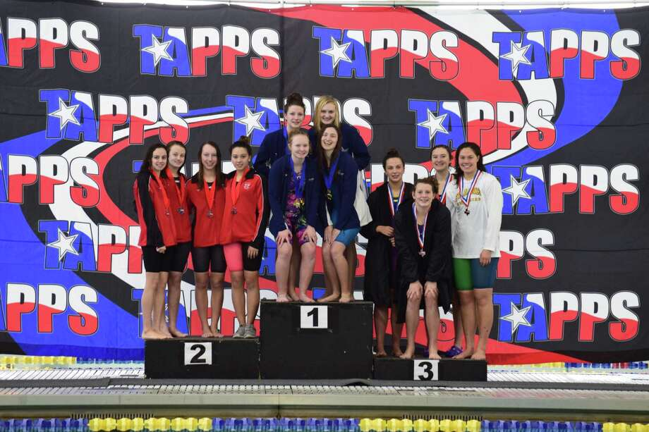 The girls 400-yard freestyle relay (bottom left: freshman, Alexis Daubendiek; bottom right: Junior Kaiti Walko; top left freshman Erin Tilley; top right senior, Monica Gumina) were state champions with a time of 3:39.71. They won the fifth gold medal for the girls. Photo: Concordia Lutheran