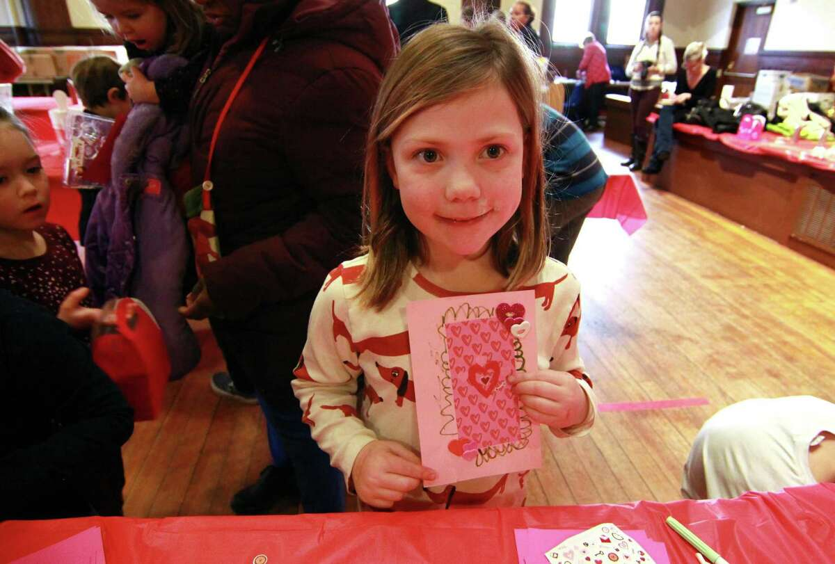 Esme Kirt, 5, of Westport, shows off the Valentine's Day card she made during Pequot Library's Kids' Candymaking Workshop in Southport, Conn., on Tuesday Feb. 13, 2018. Kids from kindergarten to 8th grade were able to make chocolate treats for Valentine's Day. They were also able to use crafts to create their own gift box and card. For future events or information, visit: www.pequotlibrary.org
