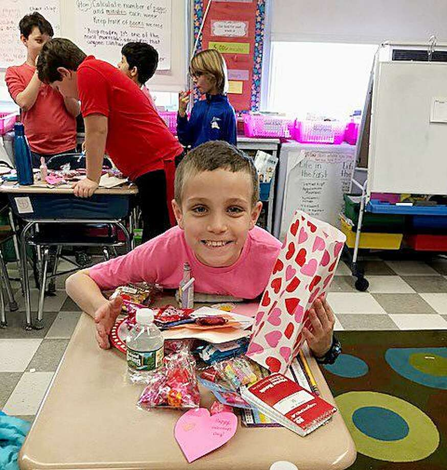Devon Tiani's fourth-grade class at Royle Elementary School celebrates Valentine's Day by wearing their favorite Valentine color and exchanging special treats. Photo: Contributed / Contributed Photo