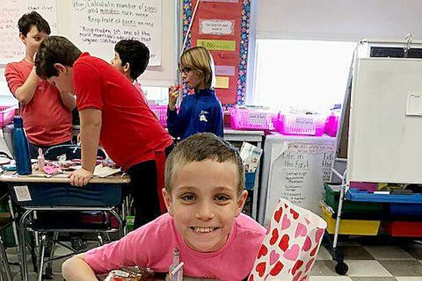 Devon Tiani's fourth-grade class at Royle Elementary School celebrates Valentine's Day by wearing their favorite Valentine color and exchanging special treats.