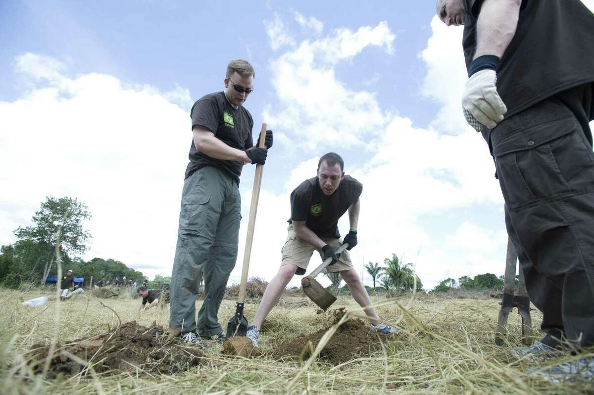"""Crius Energy and Viridian CEO Michael Fallquist (left) works in 2011 in Brazil alongside independent Viridian associates on the first phase of Viridian's """"Seven Continents in Seven Years"""" initiative to undertake environmental sustainability projects globally. (Photo: Business Wire)"""