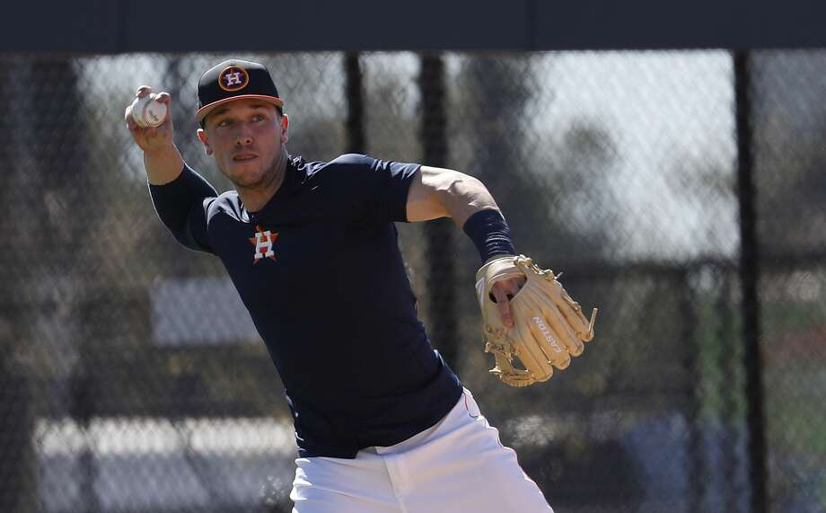 Houston Astros third baseman Alex Bregman throws the ball as he ran some drills with other early arriving position players during spring training at The Ballpark of the Palm Beaches, Friday, Feb. 16, 2018, in West Palm Beach .   ( Karen Warren / Houston Chronicle ) Photo: Karen Warren/Houston Chronicle