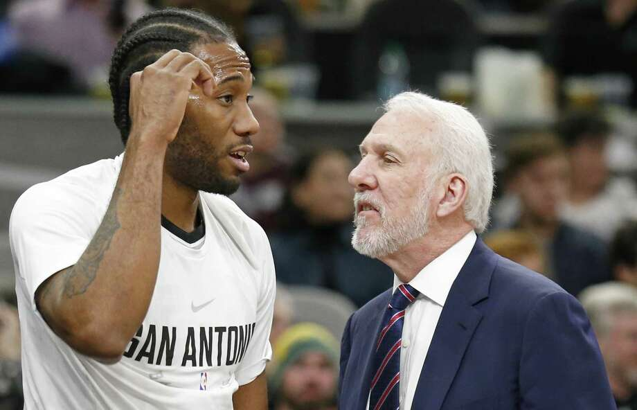 San Antonio Spurs' Kawhi Leonard talks with San Antonio Spurs head coach Gregg Popovich on the bench during first half action against the Denver Nuggets Saturday Jan. 13, 2018 at the AT&T Center. Photo: Edward A. Ornelas, Staff / San Antonio Express-News / © 2018 San Antonio Express-News