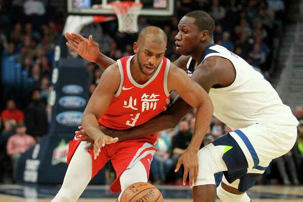 Houston Rockets guard Chris Paul (3) is fouled by Minnesota Timberwolves center Gorgui Dieng (9) during an NBA basketball game Tuesday, Feb. 13, 2018, in Minneapolis. The Rockets defeated the Timberwolves 126-108. (AP Photo/Andy Clayton-King)