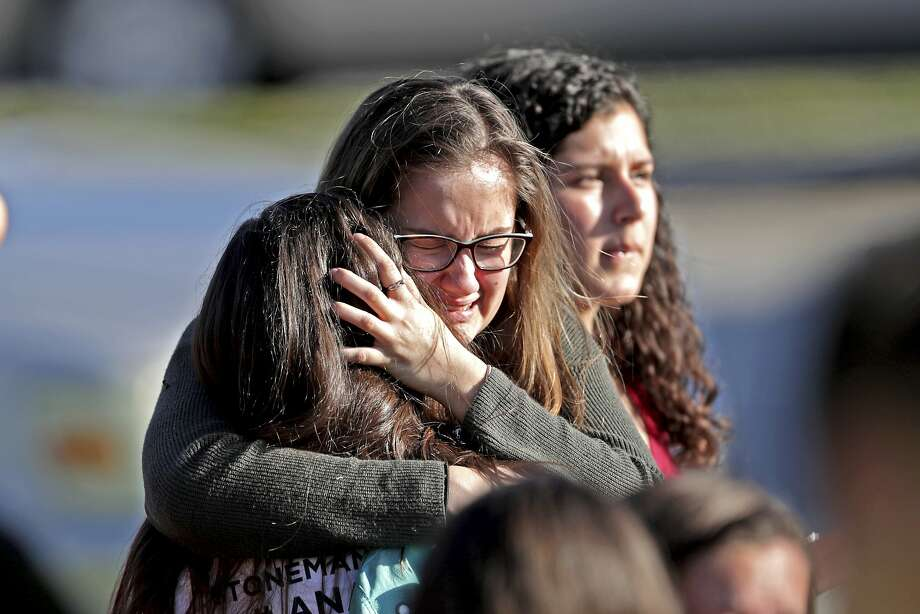 Students console each other after it was all over the day of the Parkland, Fla., massacre of Feb. 14. Photo: John McCall, Associated Press