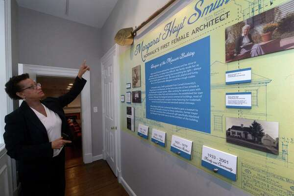 Executive Director of the Norwalk Historical Society Diane Jellerette leads a tour of the Norwalk Historical Society Museum, including the new exhibit on architect Margaret Hoyt Smith on Thursday in the historic Lockwood house. The Lockwood house was designed by Margaret Hoyt Smith, Norwalk's first female architect.