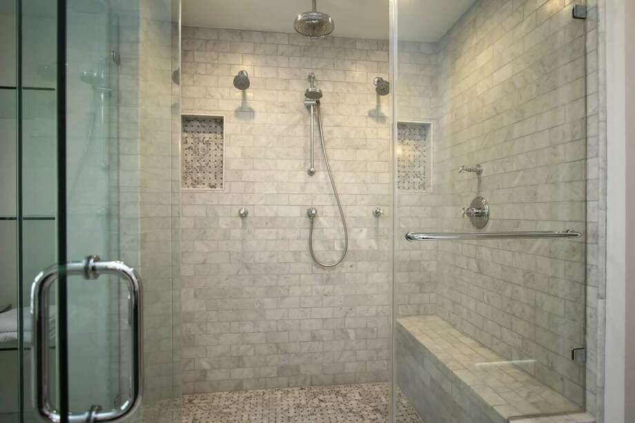 This frameless glass shower door showcases tile work. Photo: Courtesy Of A-Plus Glass Services