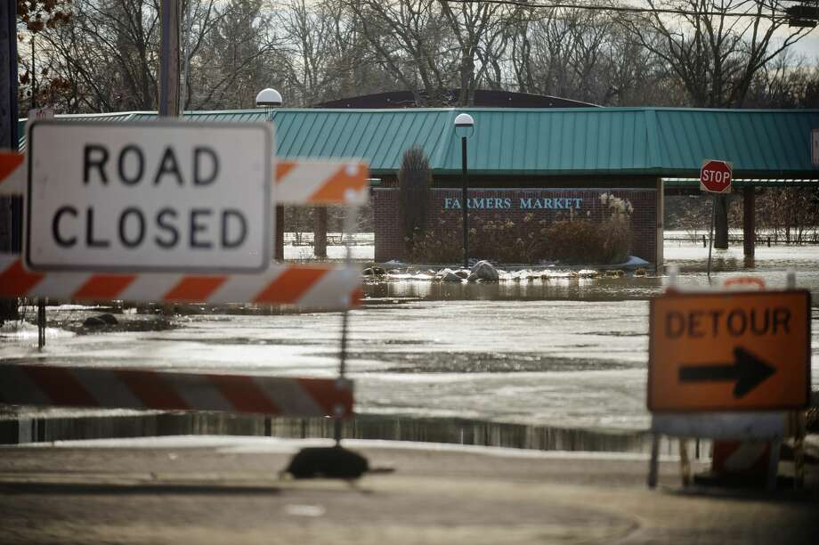Water covers the Farmer's Market on Thursday, Feb. 22, 2018 after the Tittabawassee River flooded in downtown Midland. (Katy Kildee/kkildee@mdn.net) Photo: (Katy Kildee/kkildee@mdn.net)