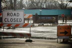 Water covers the Farmer's Market on Thursday, Feb. 22, 2018 after the Tittabawassee River flooded in downtown Midland. (Katy Kildee/kkildee@mdn.net)