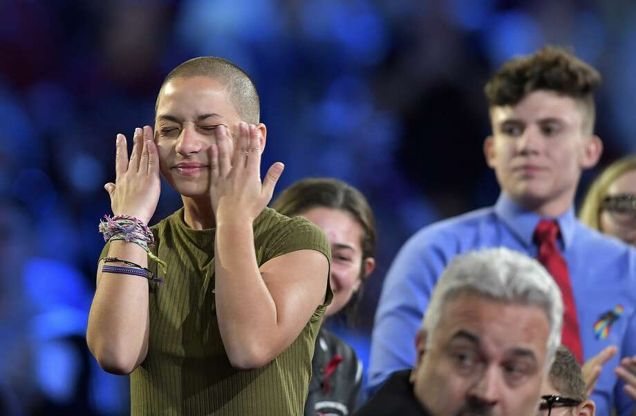 Marjory Stoneman Douglas High School student Emma Gonzalez wipes away tears during a CNN town hall meeting, Wednesday, Feb. 21, 2018, at the BB&T Center, in Sunrise, Fla. (Michael Laughlin/South Florida Sun-Sentinel via AP) Photo: Michael Laughlin/AP