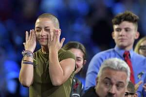 Marjory Stoneman Douglas High School student Emma Gonzalez wipes away tears during a CNN town hall meeting, Wednesday, Feb. 21, 2018, at the BB&T Center, in Sunrise, Fla. (Michael Laughlin/South Florida Sun-Sentinel via AP)