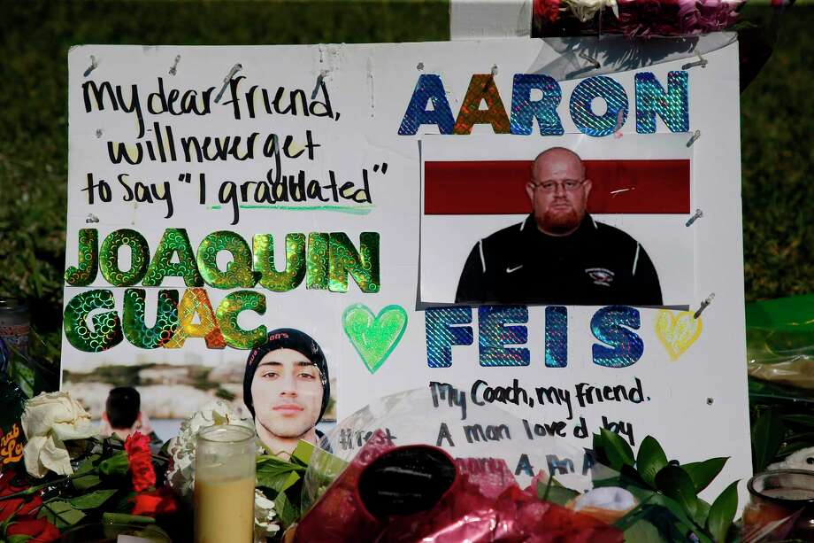 A memorial for student Joaquin Oliver and assistant football coach Aaron Feis, two of the victims of the Marjory Stoneman Douglas High School shooting, sits in a park in Parkland, Florida on February 16, 2018.   A former student, Nikolas Cruz, opened fire at the Florida high school leaving 17 people dead and 15 injured. / AFP PHOTO / RHONA WISERHONA WISE/AFP/Getty Images Photo: RHONA WISE, AFP/Getty Images / AFP or licensors