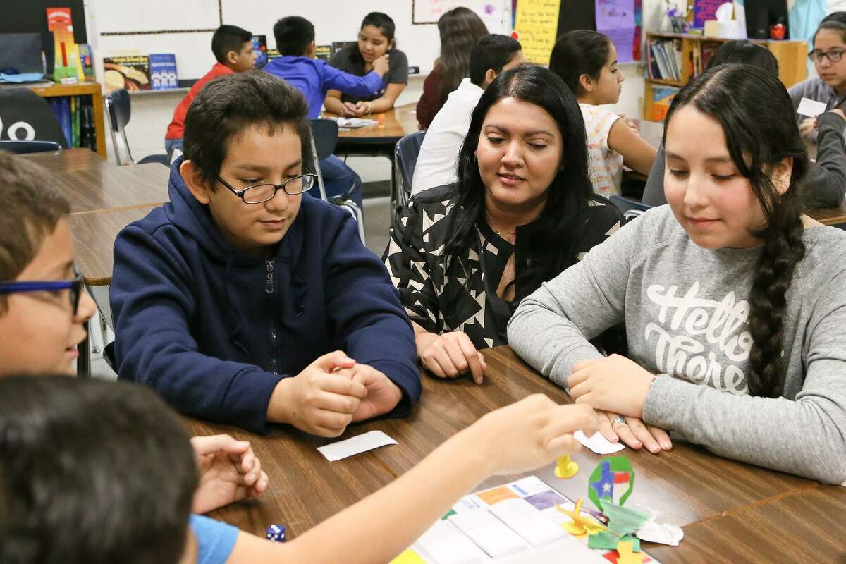 A new partnership in San Antonio can boost after-school learning and help the area reach educational goals. Here, Gloria Galvan, a bilingual fifth grade teacher at Price Elementary School, engages in a science vocabulary word game with students.