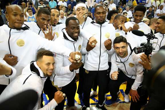 OAKLAND, CA - OCTOBER 17:  The Golden State Warriors display their 2017 NBA Championship rings prior to their NBA game against the Houston Rockets at ORACLE Arena on October 17, 2017 in Oakland, California. NOTE TO USER: User expressly acknowledges and agrees that, by downloading and or using this photograph, User is consenting to the terms and conditions of the Getty Images License Agreement.  (Photo by Ezra Shaw/Getty Images)