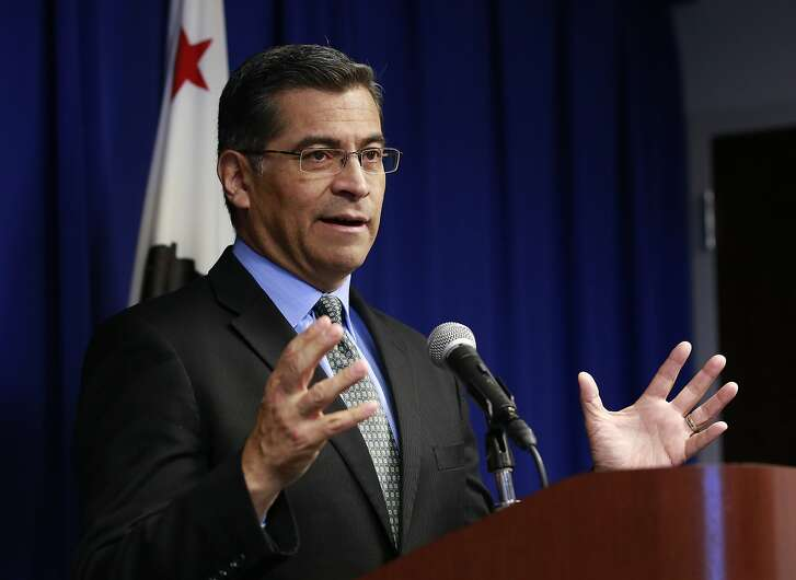 California Attorney General Xavier Becerra discusses the need for bail reform, Tuesday, Feb. 20, 2018, in Sacramento, Calif. Becerra said judges must consider suspects' ability to pay when they set bail amounts, adding momentum to ongoing talks aimed at finding a better way to make sure suspects show up in court. (AP Photo/Rich Pedroncelli)