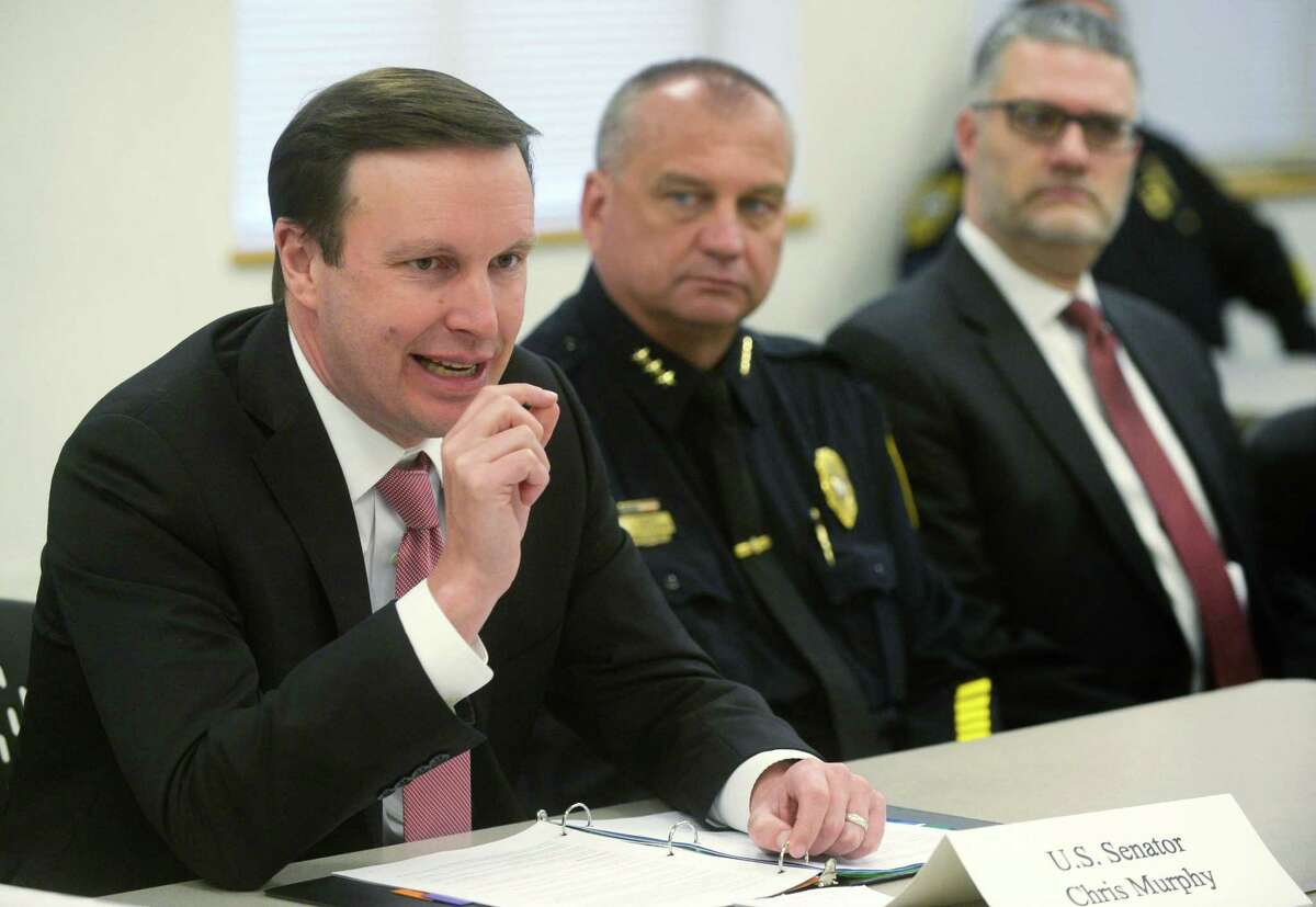 US Sen. Chris Murphy, D-Conn., speaks as Norwalk Police Chief Thomas Kulhawik and State's Attorney Richard Colangelo look on as Murphy and Congressman Jim Himes (D-CT) visit the Norwalk Police Department Thursday, February 22, 2018, to speak with emergency responders, medical professionals and patients about securing new emergency funding to expand opioid addiction treatment and prevention services during the roundtable discussion in Norwalk, Conn.