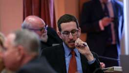 State Sen. Scott Wiener checks his mobile phone after state Sen. Tony Mendoza tendered his resignation at the State Capitol in Sacramento, Calif. on Thursday, Feb. 22, 2018 following allegations of sexual misconduct.