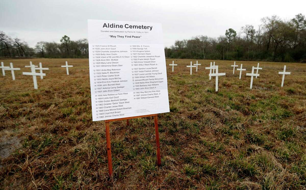 A sign with the names of those buried at the Aldine Community Cemetery, among the white crosses put up to symbolize them, Saturday, Feb. 10, 2018, in Aldine. The cemetery was vandalized at the end of 2016. Workers removed headstones and trees. Relatives of people buried there plan to place markers designating some of the sites of the estimated 40 people buried at the cemetery. ( Karen Warren / Houston Chronicle )