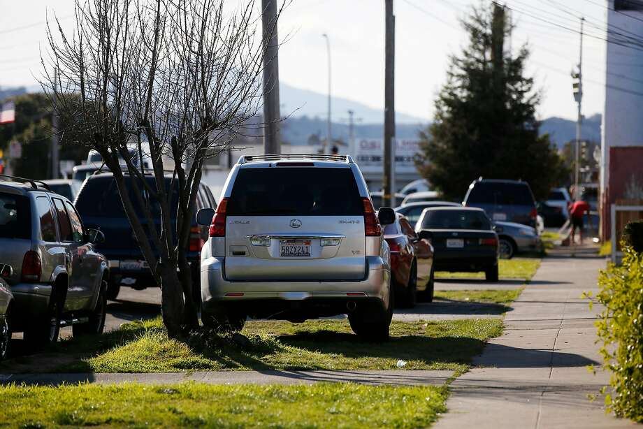 Cars sit on grassy patches along Rheem Avenue  in Richmond, Calif., on Wednesday, February 21, 2018. Photo: Lea Suzuki, The Chronicle