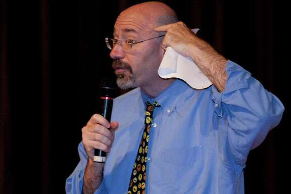 6/3/2011 :  Mike Feinberg, super intendant and co-founder of KIPP schools talks the students about reading. Principal Olive Moore with KIPP Dream Prep promise the kids if they read 28,000 books this school year she would eat worms at the end of the school year award cermony. The worms prepared by Chef Randy Rucker of the Bootsie Heritage Cafe' prepared the worms with pickled chili, pickled tomato, elder flower and smoke salt. Moore ate four worms and fed one worm to Dan Caesar, principal of KIPP 3D academy. Special to the Chronicle: Thomas B. Shea