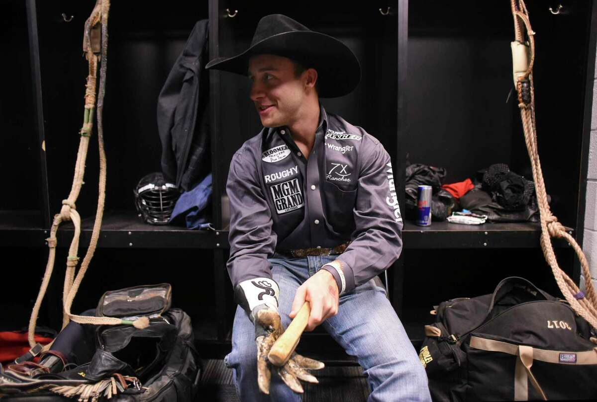 Bullrider Sage Kimzey prepares his equipment before his turn at the San Antonio Stock Show & Rodeo at the AT&T Center on Wednesday Feb. 21 2018.