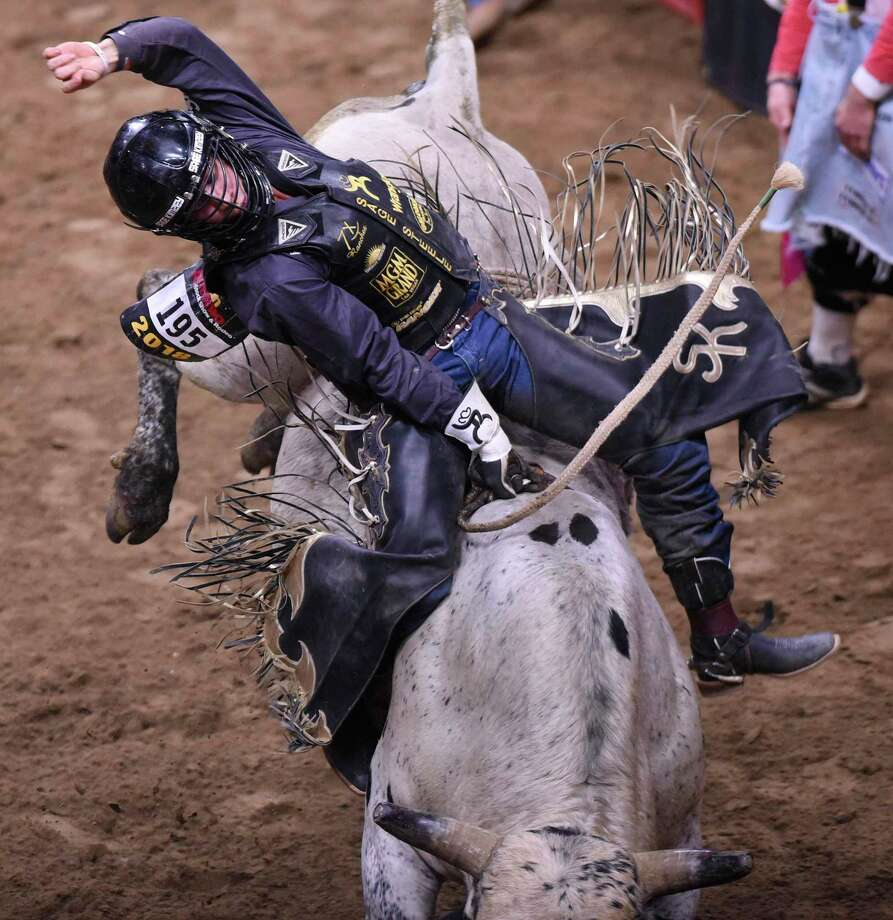 Sage Kimzey rides a bull during the San Antonio Stock Show & Rodeo at the AT&T Center in 2018. He's won the title here twice and earned $170,000 in his six trips here. . Photo: Billy Calzada / San Antonio Express-News / San Antonio Express-News