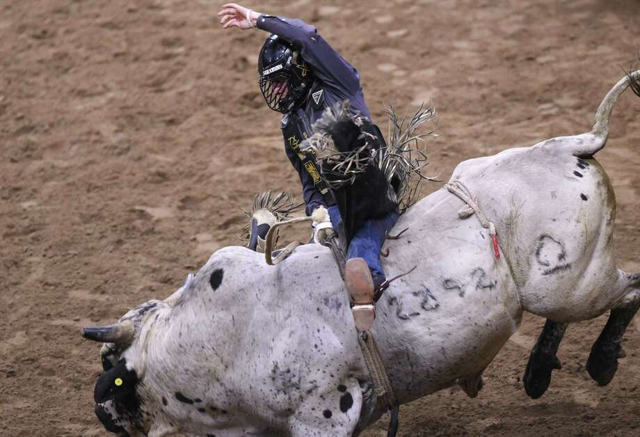 Sage Kimzey rides a bull during the San Antonio Stock Show & Rodeo at the AT&T Center on Wednesday Feb. 21 2018. His score was 84.50. Photo: Billy Calzada, Staff / San Antonio Express-News / San Antonio Express-News