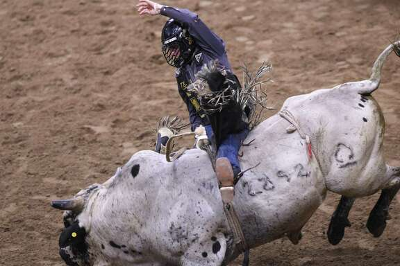 Sage Kimzey rides a bull during the San Antonio Stock Show & Rodeo at the AT&T Center on Wednesday Feb. 21 2018. His score was 84.50.