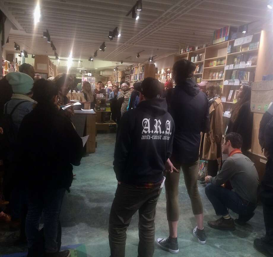 """Pro-immigration activists speak at a Feb. 19, 2018 book signing for Francisco Cantú, a former Border Patrol Agent and the author of """"The Line Becomes a River,"""" at Green Apple Books on the Park. Photo: Caille Millner, Caille Millner/The San Francisco Chronicle"""